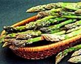 photo of a clay serving dish full of asparagus