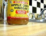 A bottle of organic apple cider vinegar with the mother