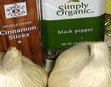photo of bulbs of garlic and cans of cinnamon and black pepper all natural remedies for diabetic treatment
