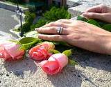 a photo of a woman's hands adjusting pick rose buds