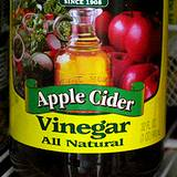 photo of the label on an Apple Cider Vinegar Bottle has many benefits of vinegar