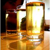 a photo of three glasses filled with apple juice good source for flush gallstones