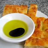 photo of balsamic vinegar and olive oil in bowl with bread along side