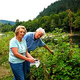 photo of an elderly couple picking blackberry leaves from their garden to make blackberry tea