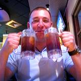 photo of a guy holding two glasses of blackberry tea
