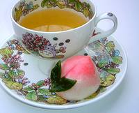 photo of a beautiful cup of chamomile tea with a edible rose on the side