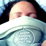 photo of a woman sleeping with blanket pulled to her nose with words sniff, sneeze, hack & splutter all symptoms of bronchitis