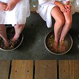 photo of a man and woman soaking their feet in a toenail fungus treatment