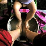 photo of father and baby enjoying a foot soak natural remedy for cold feet