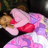 photo of a girl laying down cuddled with a hot water bottle