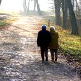 grandma and grandpa taking a long walk to boost immune system