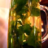 glass of homemade tea with mint and camomile headache remedies