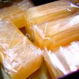A stack of candles made from honey wrapped in plastic