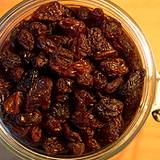 photo of dark raisins in canning jar one ingredient in recipe for natural remedy for arthritis