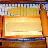 rolling pin and board for cooking pasta