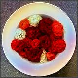 photo of a platefull of differnt colors of roses