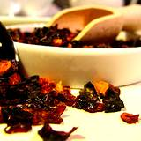 photo of a bowl overflowing with dried rose hips