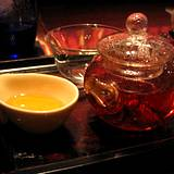 photo of a teapot and teacups filled with fresh brewed rose hip tea