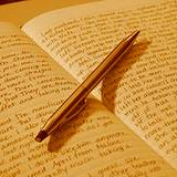 photo of a journal and pen keeping a diary is a good way to reduce sleep disorders