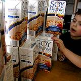 photo of a boy with a large display of soy dream milk a natural source as menopause remedy