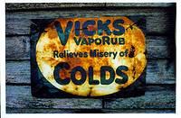 photo of a sign displaying Vicks VapoRub for colds
