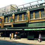 A building displaying sign The Vinegar Factory
