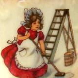 An old fashioned girl scrubbing the floor with white vinegar