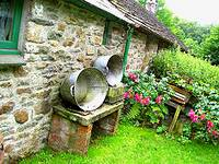 photo of a beautiful cottage with wash tubs sitting along side to take a milk bath to expel tapeworms