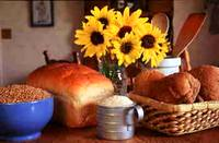 photo of a table full of breads, rice, grains and sunflowers