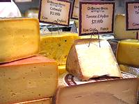 a display of a variety of Italian cheeses